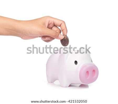 Inserting a coin into a piggy bank isolated on white background