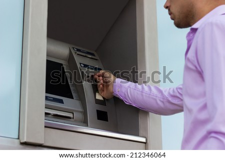 Inserting card into cash dispenser