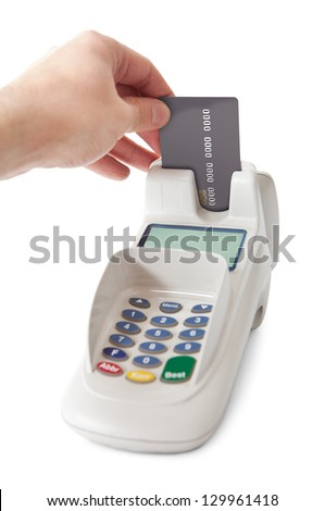 Inserting credit card into bank terminal. Isolated on white - stock photo
