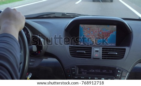 Inside a car. A GPS module is on. Close-up shot