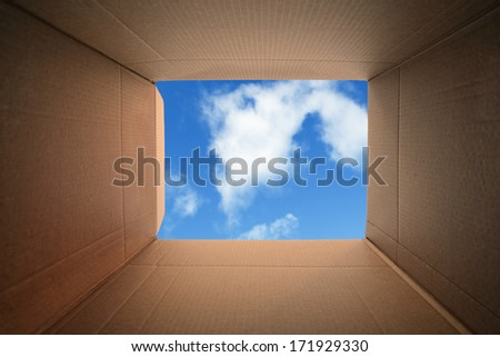Inside a cardboard box concept for moving house, creativity or thinking outside the box - stock photo
