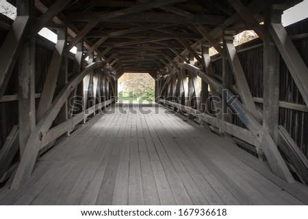 Inside a covered bridge - stock photo