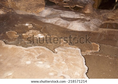 Inside a large underground limestone cave - stalagmite ad stalactite in Cave of Bear in Poland - stock photo