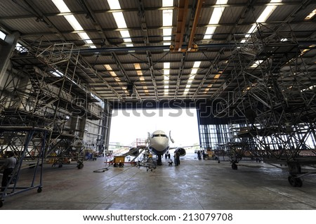 Inside aerospace hangar - stock photo