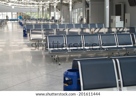Inside airport - airport seating in big airport - stock photo
