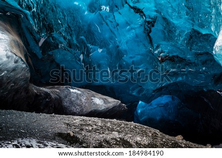 Inside an icecave in Vatnajokull, Iceland, the ice is thousands of years old and so packed it is harder than steel and crystal clear.  - stock photo