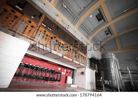 inside an old abandoned industrial building, control room - stock photo