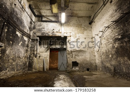 inside an old industrial building, basement with little light - stock photo