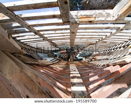Inside an old wooden fishing boat being restored - stock photo