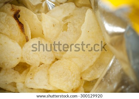 Inside bag of potato chips closed up - stock photo