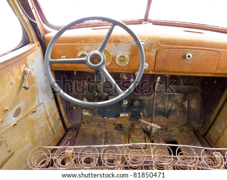 Inside cab view of rusty old junked pick-up truck. - stock photo