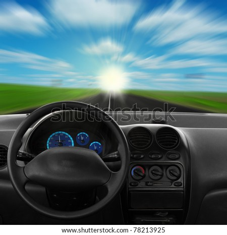 Inside car view at high speed. and sky - stock photo