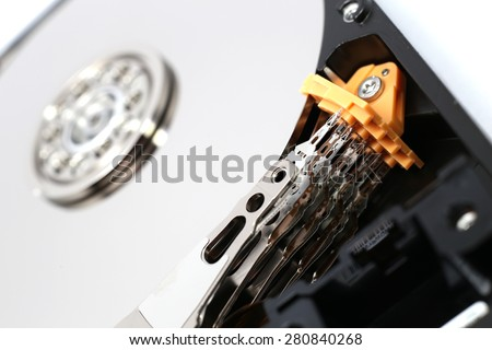 Inside Hard Disk Drive (HDD)-Computer Hardware Components Focus on Head. - stock photo