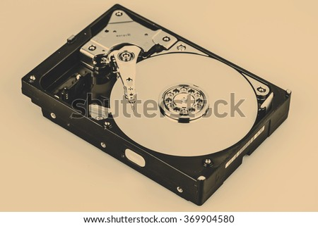Inside Hard disk drive HDD isolated on white background - stock photo