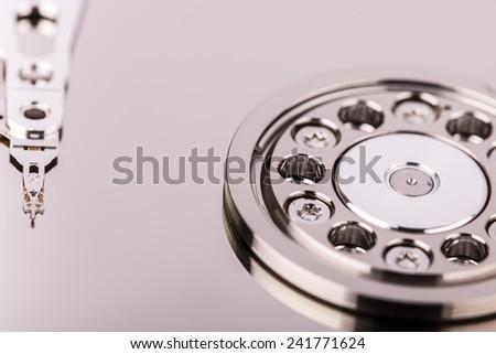 Inside Hard disk drive HDD isolated on white background - storage medium - stock photo