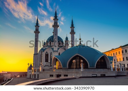 Inside Kazan Kremlin, Russia. Aerial view of Qol Sharif Mosque and other historical buildings during at sunset .Colorful yellow and blue cloudy sky - stock photo