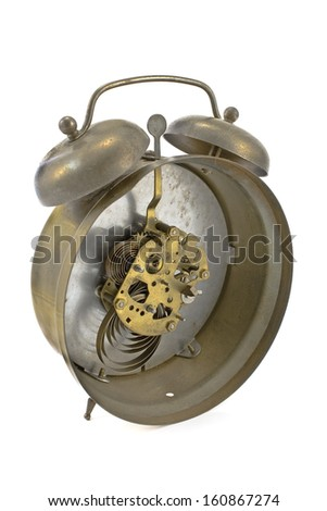 Inside mechanism of old alarm clock isolated on white - stock photo