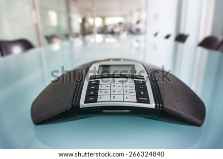 Inside modern call conference room, focus on phone - stock photo