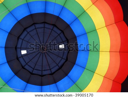 Inside of a colorful hot air ballon - stock photo