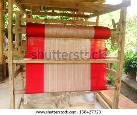 Inside of a damask weaving machine - stock photo