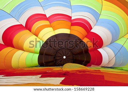 inside of a hot air balloon at the beginning of inflating  - stock photo