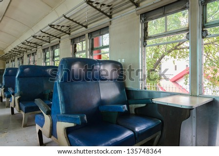 Inside of a last century old train passenger carriage - stock photo