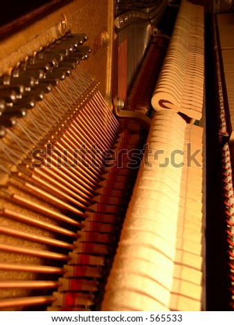Inside of a piano from low note side - stock photo