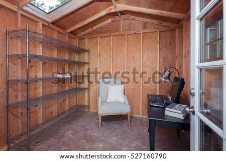 Inside of a wooden Garden Shed used as home office.