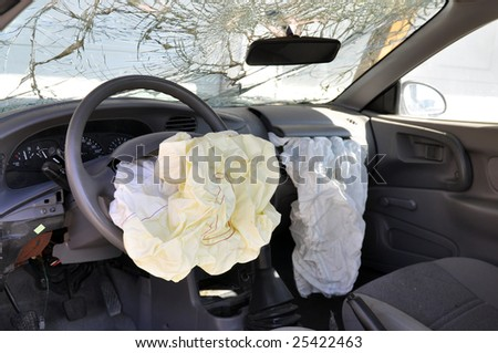Inside of a wrecked car. - stock photo