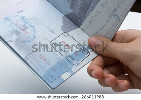 Inside of American Passport with Departure/Arrival Stamps - stock photo