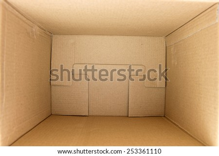Inside of an empty square cardboard box - stock photo