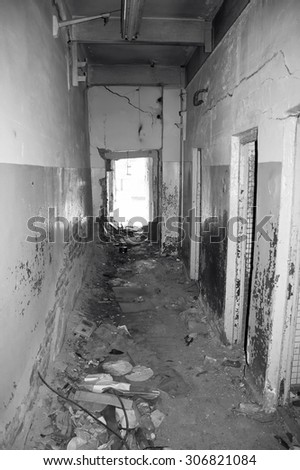 Inside of destroyed house. Ruins of home. Black and white photo - stock photo