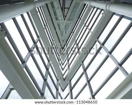 inside of glass windows pattern on modern building - stock photo
