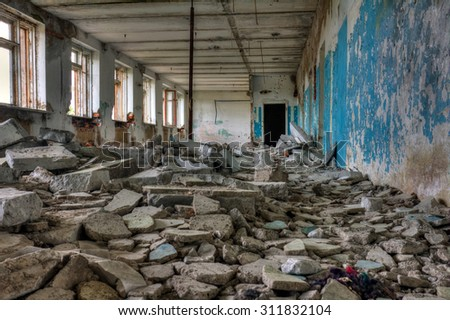 Inside of old abandoned building - stock photo