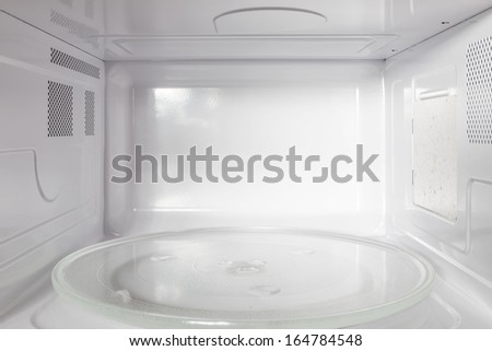 Inside of the microwave oven - stock photo