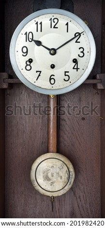inside of vintage wind up wall clock - stock photo
