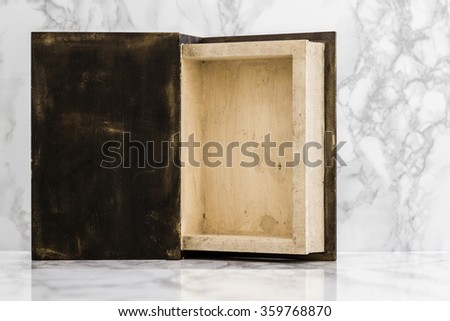 Inside of wooden box on white marble table