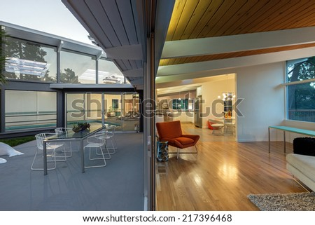 Inside outside view of mid century home.  - stock photo
