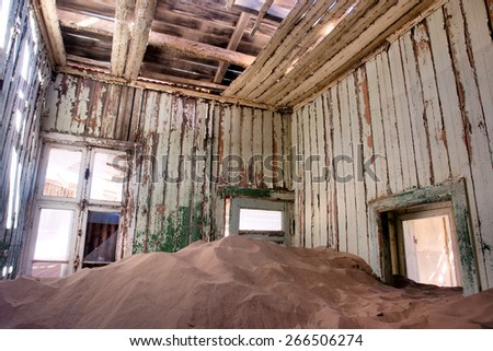 Inside the abandoned house in desert. Shot in a ghost town, Namibia. - stock photo