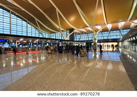 inside the airport terminal in shanghai - stock photo