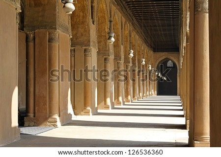 Inside the arcaded corridors of Ibn Tulun Mosque Cairo - stock photo