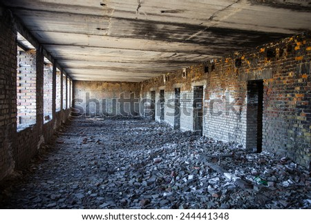 Inside the old ruined and abandoned brick building. - stock photo