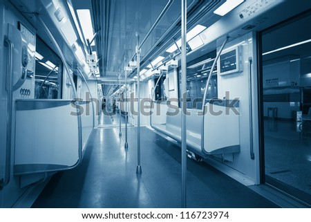 inside the subway car in shanghai with blue tone - stock photo