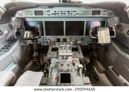 Inside view Cockpit Airplane Aircraft with blue sky and clouds