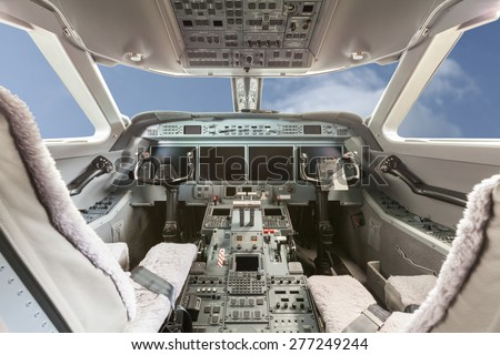 Inside view Cockpit G550 with blue sky and clouds - stock photo