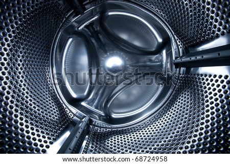Inside view into a washing machine - stock photo