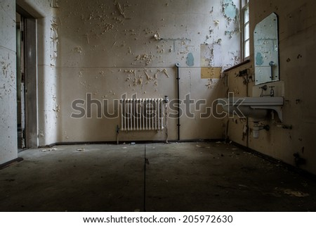 inside view of a deserted room with an old radiator - stock photo