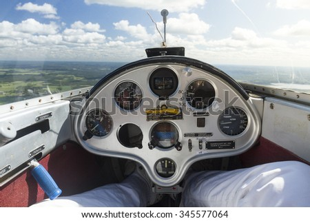 Inside view of a glider plane cockpit and instrument dashboard panel - stock photo