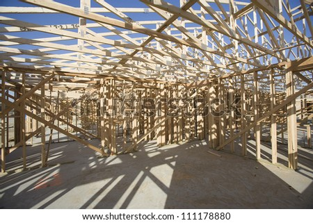 Inside view of roof structure of a wooden house under construction
