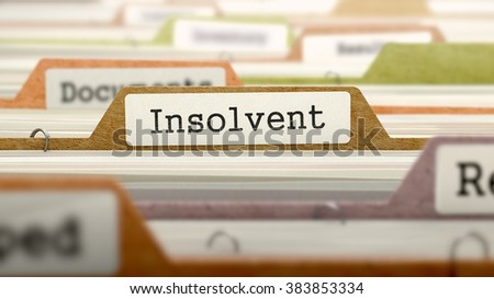 Insolvent - Folder Register Name in Directory. Colored, Blurred Image. Closeup View. 3D Render.